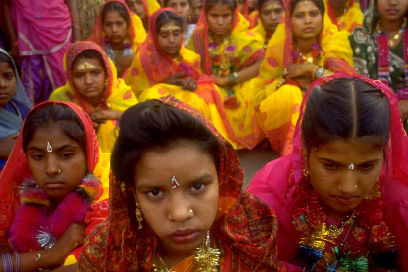 Caption With other girls behind them, a group of girl brides sit together solemnly during the celebrations leading up to their wedding later that night, in the Rajgarh district of Madhya Pradesh state.      Credit must be given:   UNICEF/HQ95-0155/ SONDEEP SHANKAR     Country INDIA